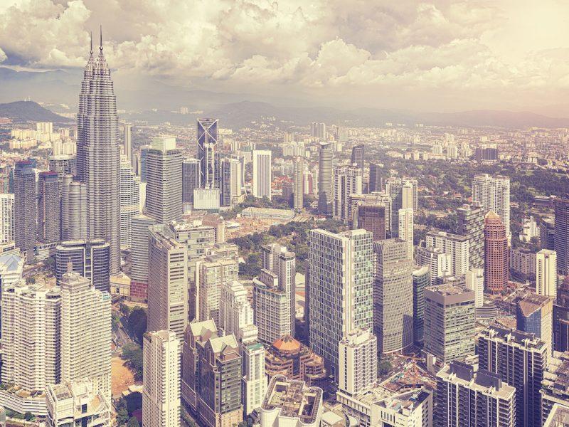 Vintage stylized photo of Kuala Lumpur skyline Malaysia.